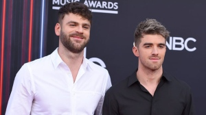 Alex Pall, left, and Andrew Taggart, of The Chainsmokers, arrive at the Billboard Music Awards at the MGM Grand Garden Arena on Sunday, May 20, 2018, in Las Vegas. (Photo by Jordan Strauss/Invision/AP)
