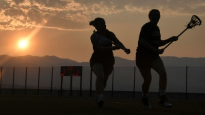 Lacrosse players practice on the first day of classes in Colorado Springs, Colorado. (Jerilee Bennett/The Gazette via AP)