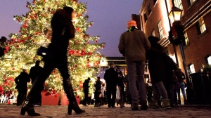 Shoppers take in the sights at the Toronto Christmas Market in The Distillery Historic District on Thursday Dec. 18, 2014. The market runs until Sunday Dec. 21, 2014. THE CANADIAN PRESS/Frank Gunn