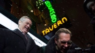 Mayor John Tory and owner of the El Mocambo Michael Wekerle answer questions after turning the historic landmark's sign back on in Toronto on Thursday November 15, 2018. THE CANADIAN PRESS/Frank Gunn