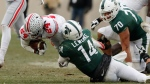 Michigan State quarterback Brian Lewerke (14) tackles Ohio State cornerback Shaun Wade (24) after Wade intercepted the pass during the second half of an NCAA college football game, Saturday, Nov. 10, 2018, in East Lansing, Mich. (AP Photo/Carlos Osorio)