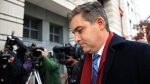 In this Nov. 14, 2018, photo, CNN's Jim Acosta walks into federal court in Washington, to attend a hearing on a legal challenge against President Donald Trump's administration. A judge is expected to announce Friday whether he will order the Trump administration to return the White House press credentials of CNN reporter Jim Acosta. (AP Photo/Manuel Balce Ceneta)