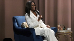"Former first lady Michelle Obama speaks at the ""Becoming: An Intimate Conversation with Michelle Obama"" event at the Forum on Thursday, Nov. 15, 2018, in Inglewood, Calif. (Photo by Willy Sanjuan/Invision/AP)"