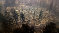 In this Thursday, Nov. 15, 2018 file photo, residences leveled by the wildfire line a neighborhood in Paradise, Calif. A Northern California sheriff dramatically increased the count of the missing from a deadly wildfire again, saying more than 1,000 people are now on the list. On Saturday, Nov. 17, President Donald Trump is expected to get a look at the grief and damage caused by the deadliest U.S. wildfire in a century. (AP Photo/Noah Berger, File)