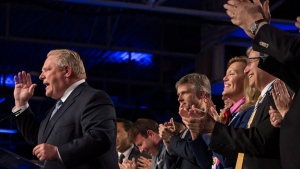 Ontario Premier Doug Ford (left) receives the applause of his caucus as he addresses the Ontario PC Convention in Toronto, on Friday November 16 , 2018. THE CANADIAN PRESS/Chris Young