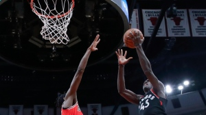 Toronto Raptors forward Pascal Siakam (43) shoots against Chicago Bulls forward Justin Holiday (7) during the second half of an NBA basketball game, Saturday, Nov. 17, 2018, in Chicago. (AP Photo/Kamil Krzaczynski)