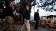 President Donald Trump visits a neighborhood impacted by the Woolsey Fire, Saturday, Nov. 17, 2018, in Malibu, Calif. At left is FEMA Administrator Brock Long. (AP Photo/Evan Vucci)