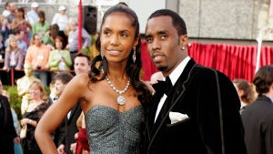 "In a Feb. 27, 2005 file photo, Sean ""P. Diddy"" Combs arrives with date, Kim Porter, for the 77th Academy Awards in Los Angeles. (AP Photo/Amy Sancetta, File)"