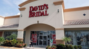 The entrance to a David's Bridal store is seen Monday, Nov. 19, 2018, in Orlando, Fla. David's Bridal is filing for bankruptcy protection but there is no danger for customers who have ordered dresses because operations are continuing as normal while the wedding and prom retailer restructures. (AP Photo/John Raoux)