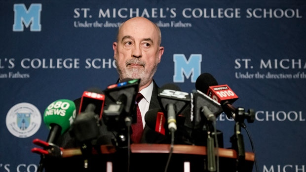 St. Michael's College School principal Gregory Reeves, speaks to reporters at the school in Toronto, Monday, Nov. 19, 2018. THE CANADIAN PRESS/Christopher Katsarov
