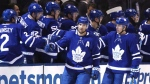 Toronto Maple Leafs centre John Tavares (91) celebrates a goal with teammates during second period NHL action against the Columbus Blue Jackets in Toronto on Monday, November 19 2018. THE CANADIAN PRESS/Cole Burston