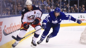 Toronto Maple Leafs centre Patrick Marleau (12) vies for the puck with Columbus Blue Jackets defenceman Seth Jones (3) during first period NHL action in Toronto on Monday, November 19 2018. THE CANADIAN PRESS/Cole Burston