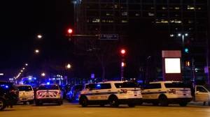 Chicago Police work the scene where a gunman opened fire at Mercy Hospital, Monday, Nov. 19, 2018, in Chicago. A police spokesman said the gunman was dead, but it was not immediately clear if he took his own life or was killed by police at the hospital on the city's South Side. (AP Photo/David Banks)