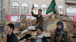 FILE - In this Dec. 4, 2017, file photo, Houthi Shiite fighters guard a street leading to the residence of former Yemeni President Ali Abdullah Saleh, in Sanaa, Yemen. (AP Photo/Hani Mohammed, File)