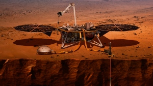 This illustration made available by NASA in 2018 shows the InSight lander drilling into the surface of Mars. InSight, short for Interior Exploration using Seismic Investigations, Geodesy and Heat Transport, is scheduled to arrive at the planet on Monday, Nov. 26, 2018. (NASA via AP)