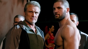 "This image released by Metro Goldwyn Mayer Pictures / Warner Bros. Pictures shows Dolph Lundgren, left, and Florian Munteanu in a scene from ""Creed II."" (Barry Wetcher/Metro Goldwyn Mayer Pictures/Warner Bros. Pictures via AP)"