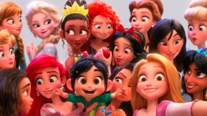 "This image released by Disney shows the character Vanellope von Schweetz, voiced by Sarah Silverman, foreground center, posing for s selfie with Disney princesses in a scene from ""Ralph Breaks the Internet."" Filmmakers invited the original voice talent to return to the studio to help bring their characters to life. (Disney via AP)"