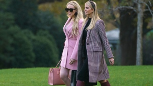 Ivanka Trump, right, and Tiffany Trump, daughters of President Donald Trump, walk on the South Lawn of the White House in Washington, Tuesday, Nov. 20, 2018, to board Marine One for the short trip to Andrews Air Force Base and onto Mar-a-Lago for Thanksgiving. (AP Photo/Carolyn Kaster)