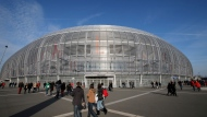 FILE - In this Saturday, Nov. 22, 2014 file photo, people walk outside the Pierre Mauroy stadium, in Lille, northern France. Yannick Noah guided France to Davis Cup titles in 1991, 1996 and 2017, but he will step down after this weekend and Amelie Mauresmo will take over. For his final match as captain of France Davis Cup team, Yannick Noah has been as meticulous as ever. (AP Photo/Christophe Ena, File)