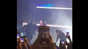 A video has surfaced online of a Pusha T concert showing three people rushing the stage.