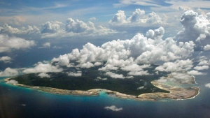 FILE – In this Nov. 14, 2005 file photo, clouds hang over the North Sentinel Island, in India's southeastern Andaman and Nicobar Islands.  (AP Photo/Gautam Singh, File)