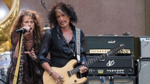 "FILE - In this Aug. 15, 2018 file photo, Steven Tyler, left, and Joe Perry of Aerosmith perform on NBC's ""Today"" show at Rockefeller Center in New York.  (Photo by Charles Sykes/Invision/AP, File)"