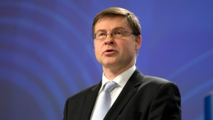 European Commission Vice-President Valdis Dombrovskis speaks during a media conference at EU headquarters in Brussels, Wednesday, Nov. 21, 2018. A top EU official says Italy's draft budget for next year is in breach of the rulebook underpinning the euro and he is signaling the start of a legal procedure against the country over the spending plan.(AP Photo/Virginia Mayo)