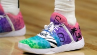 Brooklyn Nets' Spencer Dinwiddie wears shoes as a tribute to Miami Heat's Dwyane Wade during the second half of an NBA basketball game against the Miami Heat, Tuesday, Nov. 20, 2018, in Miami. The Nets won 104-92. This is Wade's last season. (AP Photo/Lynne Sladky)