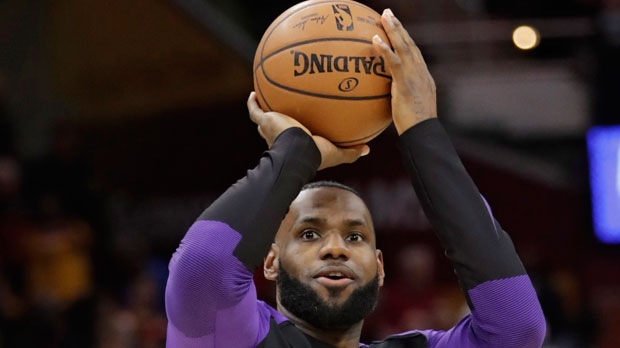 Los Angeles Lakers  LeBron James warms up before the team s NBA basketball  game against the Cleveland Cavaliers 6a2e341a5
