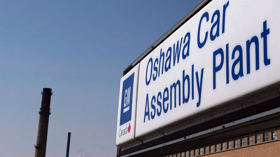 A sign stands outside Oshawa's General Motors on Monday, September 17, 2012.  THE CANADIAN PRESS/Michelle Siu