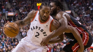 Toronto Raptors' Kawhi Leonard, left, drives at Miami Heat's Justise Winslow during first half NBA basketball action in Toronto on Sunday, November 25, 2018. THE CANADIAN PRESS/Chris Young