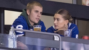 Justin Bieber watches alongside his wife Hailey Baldwin, right, during NHL hockey action between the Philadelphia Flyers and the Toronto Maple Leafs, in Toronto on Saturday, Nov. 24, 2018. THE CANADIAN PRESS/Chris Young