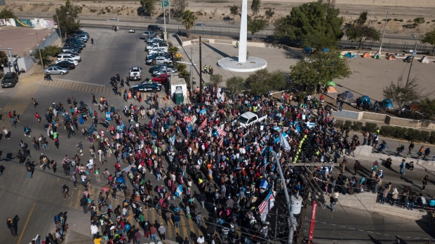 U.S. shoots tear gas as migrants rush border
