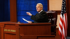 "In this undated image provided by NBC shows Jerry Springer in a scene from ""Judge Jerry."" (Bennett Raglin/NBC via AP)"