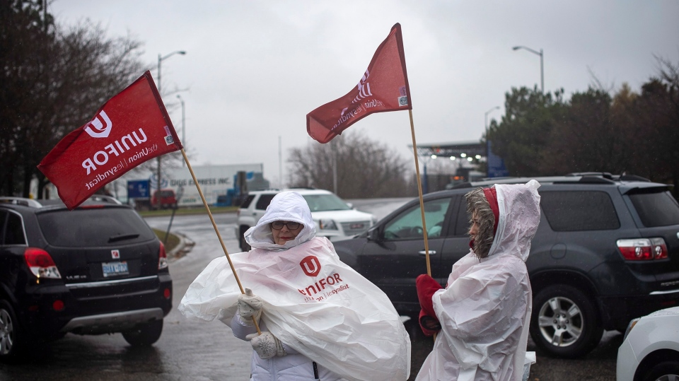 Members of Unifor, the union representing the workers of Oshawa's General Motors car assembly plant, parked their to block the entrance to the plant, Ont., Monday Nov 26 , 2018. General Motors will close its production plant in Oshawa, Ont., along with four facilities in the U.S. as part of a global reorganization that will see the company focus on electric and autonomous vehicle programs. THE CANADIAN PRESS/Eduardo Lima