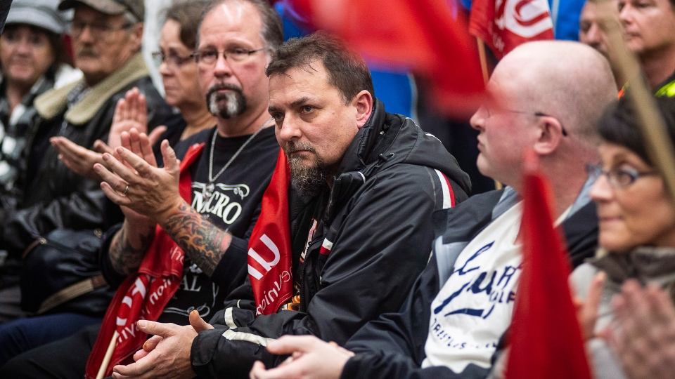 Workers of Oshawa's General Motors car assembly plant, listen to Jerry Dias, president of UNIFOR, the union representing the workers, at the union headquarters in Oshawa, Ont. on Monday, Nov. 26, 2018. THE CANADIAN PRESS/Eduardo Lima