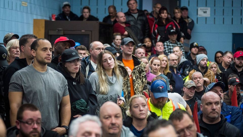 Workers of Oshawa's General Motors car assembly plant, listen to Jerry Dias, president of UNIFOR, the union representing the workers, at the union headquarters, in Oshawa, Ont. on Monday, Nov. 26, 2018. THE CANADIAN PRESS/Eduardo Lima