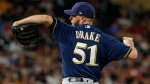 Milwaukee Brewers relief pitcher Oliver Drake throws to the Minnesota Twins in the sixth inning of a baseball game Monday, Aug. 7, 2017, in Minneapolis. (AP Photo/Bruce Kluckhohn)