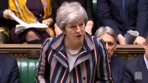 Britain's Prime Minister Theresa May makes a statement on Brexit to the House of Commons in London, Monday Nov. 26, 2018. May has two-weeks to convince the British public, and a skeptical Parliament, to back the Brexit deal she has struck with the European Union. (House of Commons / PA via AP)