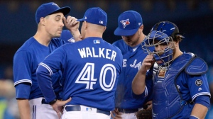 Toronto Blue Jays starting pitcher Aaron Sanchez (left) gets a mound visit from pitching coach Pete Walker as catcher Russell Martin (right) and first baseman Justin Smoak listen in during sixth inning American League baseball action against the Chicago White Sox in Toronto on Wednesday, April 4, 2018. THE CANADIAN PRESS/Nathan Denette