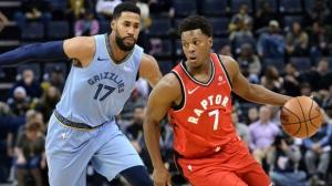 Toronto Raptors guard Kyle Lowry (7) controls the ball against Memphis Grizzlies guard Garrett Temple (17) in the first half of an NBA basketball game, Tuesday, Nov. 27, 2018, in Memphis, Tenn. (AP Photo/Brandon Dill)