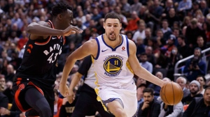Golden State Warriors guard Klay Thompson (11) drives against Toronto Raptors forward Pascal Siakam (43) during second half NBA basketball action in Toronto on Saturday January 13, 2018. THE CANADIAN PRESS/Cole Burston