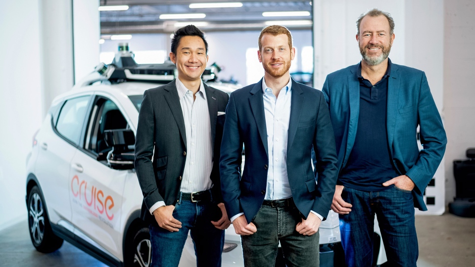 In this Nov. 20, 2018, photo provided by General Motors/Cruise, from left, Cruise Automation's Dan Kan and Kyle Vogt pose for a photo with General Motors' Dan Ammann at Cruise Automation offices in San Francisco, Calif. General Motors' No. 2 executive is moving from Motor City to Silicon Valley to run the automaker's self-driving car operations as it attempts to cash in on its bet that robotic vehicles will transform transportation. In a transition announced Thursday, Nov. 29, GM President Ammann will become CEO of the company's Cruise Automation subsidiary at the beginning of next year. He will replace Cruise co-founder Vogt, who will become chief technology officer. (Noah Berger/General Motors, Cruise via AP)