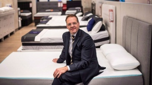 "Sleep Country Canada holdings Inc. says it will acquire online mattress retailer Endy for nearly $89 million. David Friesema, the CEO of Sleep Country Canada, sits on the new ""Bloom"" mattress, as he poses for a photo at a store in Toronto on Wednesday, May 10, 2017. The Toronto-based company says its signed a definitive agreement to acquire the mattress-in-a-box firm, a Canadian start-up that launched in 2015. THE CANADIAN PRESS/Aaron Vincent Elkaim"