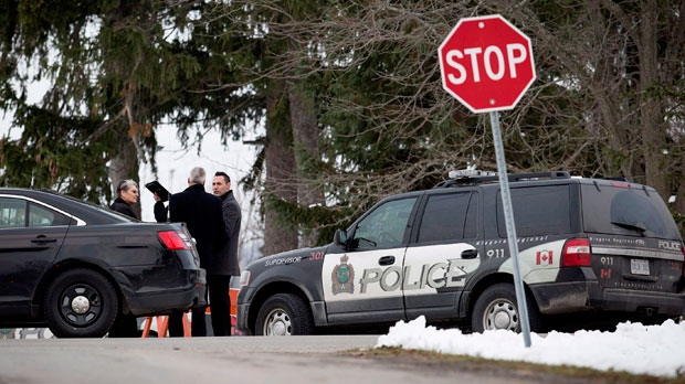 Niagara Regional Police, OPP and the SIU attend a scene near Effingham Street and Roland Road in Pelham, Ont., where a Niagara Regional Police officer was shot by a fellow officer, Thursday, Nov. 29, 2018. THE CANADIAN PRESS/Aaron Lynett