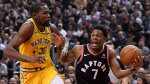 Toronto Raptors guard Kyle Lowry (7) moves up court as Golden State Warriors forward Kevin Durant (35) defends during first half NBA basketball action in Toronto on Thursday Nov. 29, 2018. THE CANADIAN PRESS/Nathan Denette