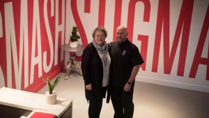 Joanne Simons, CEO of Casey House and Randy Davis, a HIV+ Healer, pose for a photo at the Healing House, the world's first pop-up HIV+ spa in Toronto on Thursday, Nov. 29, 2018. THE CANADIAN PRESS/Tijana Martin