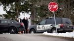 Niagara Regional Police, OPP and the SIU attend a scene near Effingham Street and Roland Road in Pelham, Ont., where a Niagara Regional Police officer was shot by a fellow officer, Thursday, Nov. 29, 2018. (THE CANADIAN PRESS/Aaron Lynett)