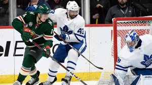 Toronto Maple Leafs goaltender Frederik Andersen (31), of Denmark, blocks a shot by Minnesota Wild's Joel Eriksson Ek (14), of Sweden, while Toronto Maple Leafs' Nazem Kadri (43) helps defend during the second period of an NHL hockey game Saturday, Dec. 1, 2018, in St. Paul, Minn. (AP Photo/Hannah Foslien)