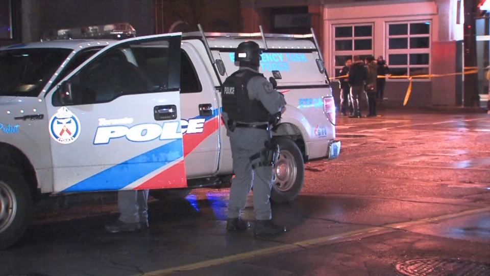 Police investigate a shooting in the area of Queen Street West and Ossington Avenue Sunday December 2, 2018.